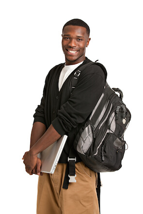 A student standing with a backpack on.