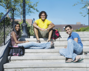 College students sitting on steps.
