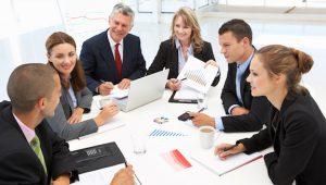Consultants meet to evaluate curriculum.