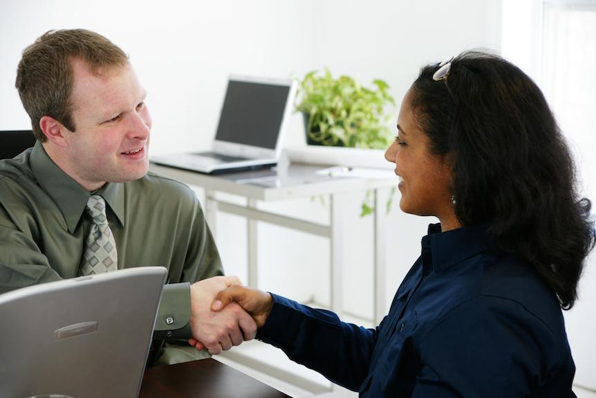 Man and women shake hands.