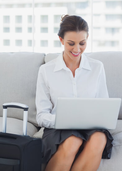 Interim placements and appointments woman with laptop and suitcase.