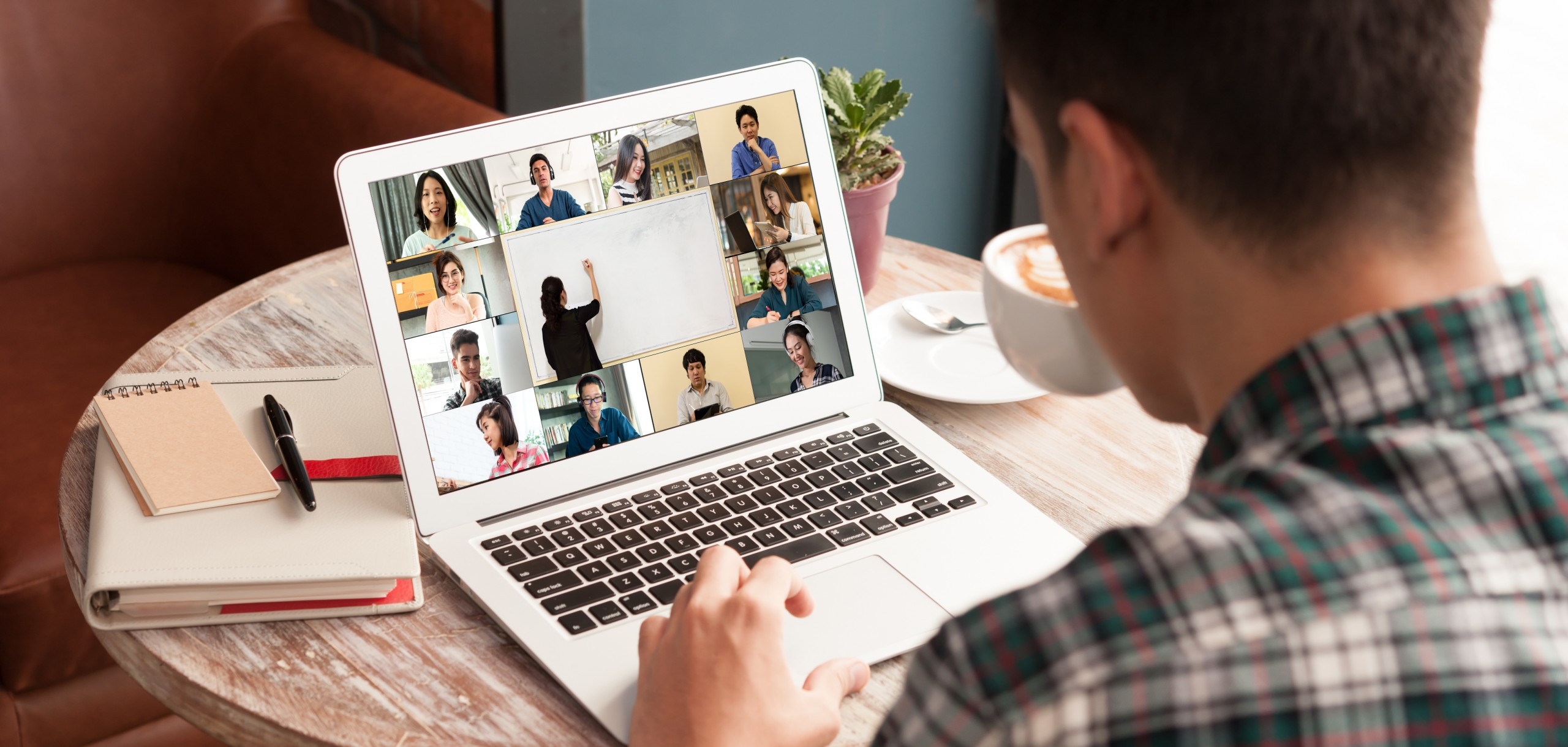 Man at computer using web conferencing software - higher education consulting firm