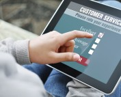 Accessible Word document Person using touch tablet to rate customer service