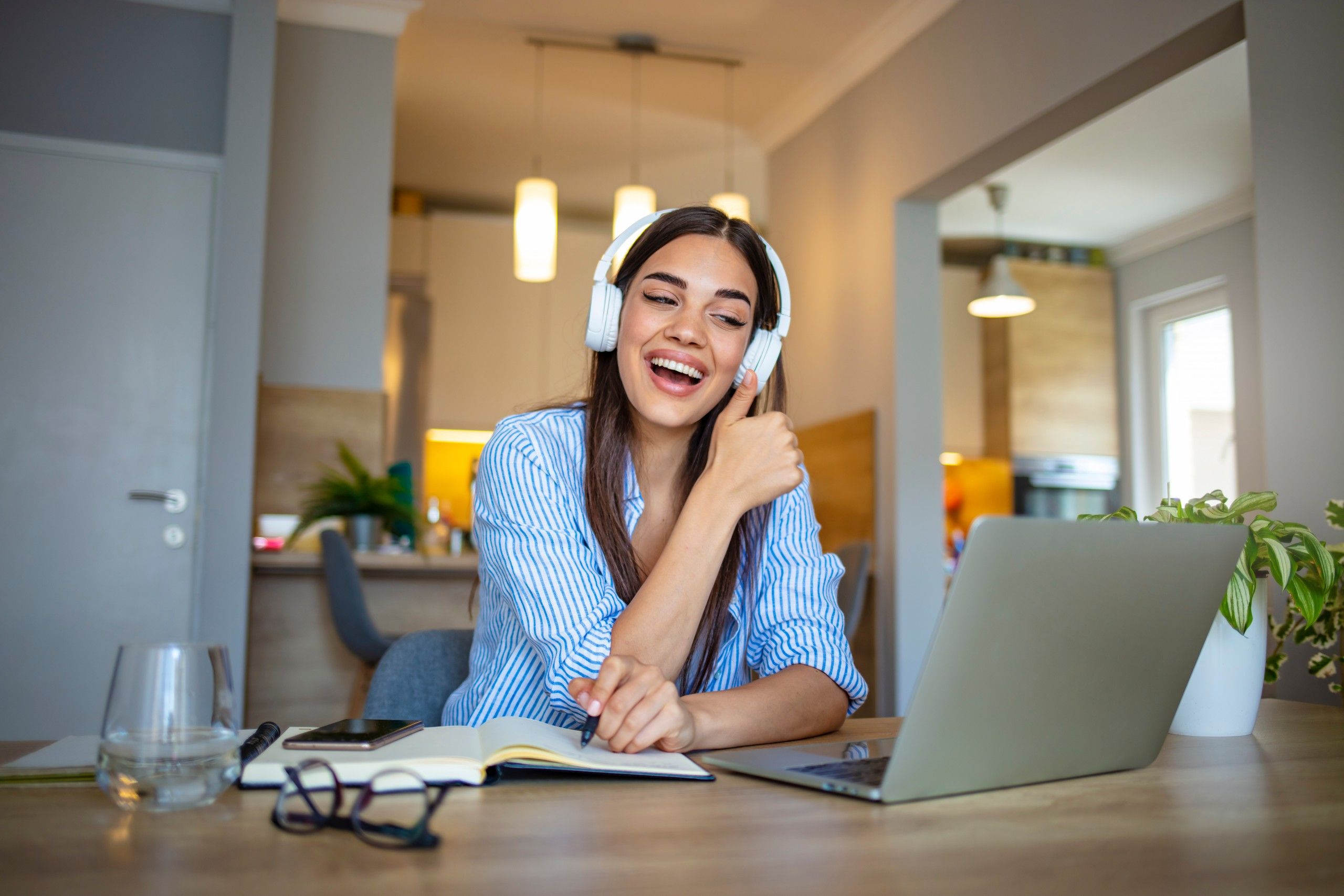 Woman using headphones for web conference