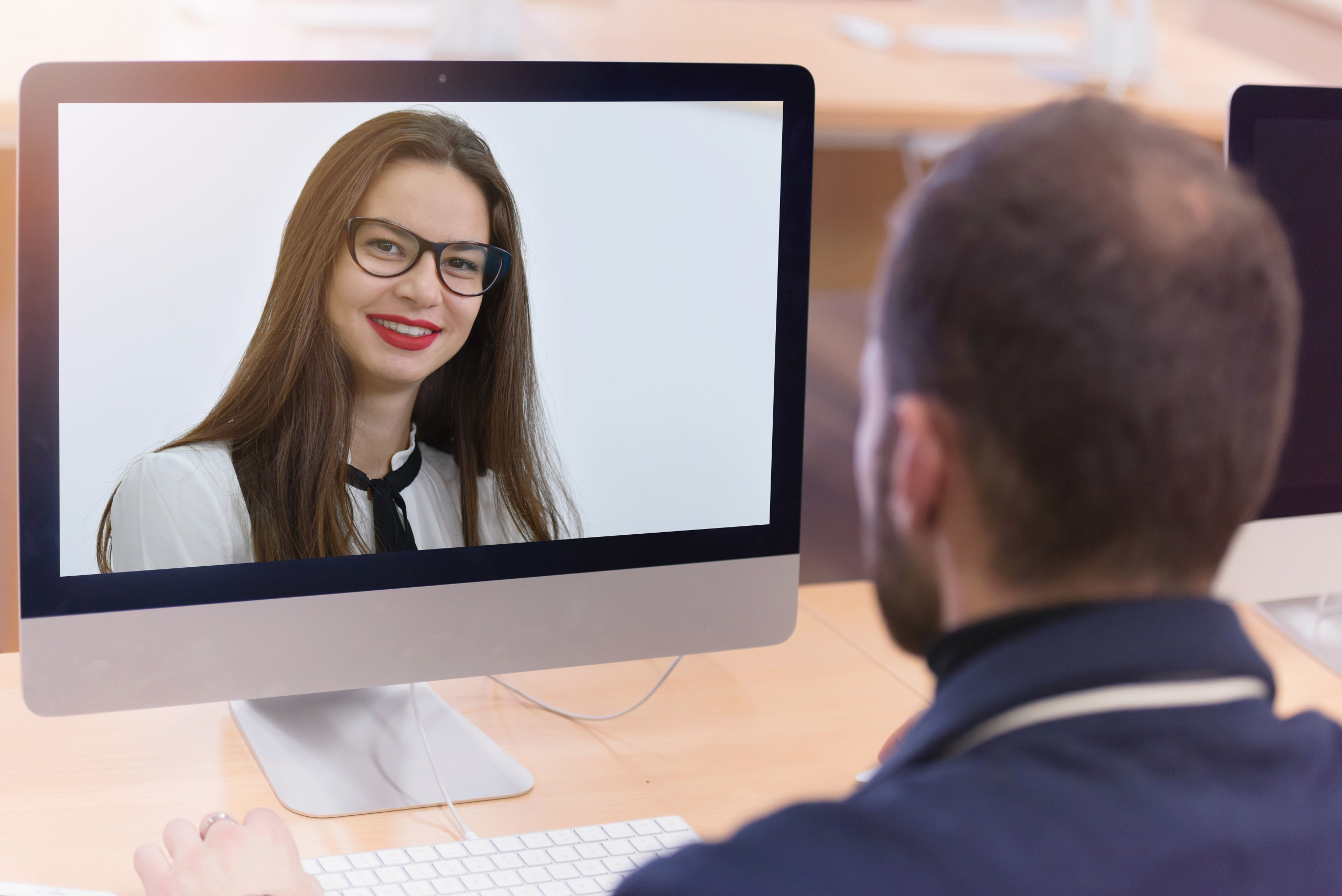 Instructional design and technology Man meeting with woman on video conference
