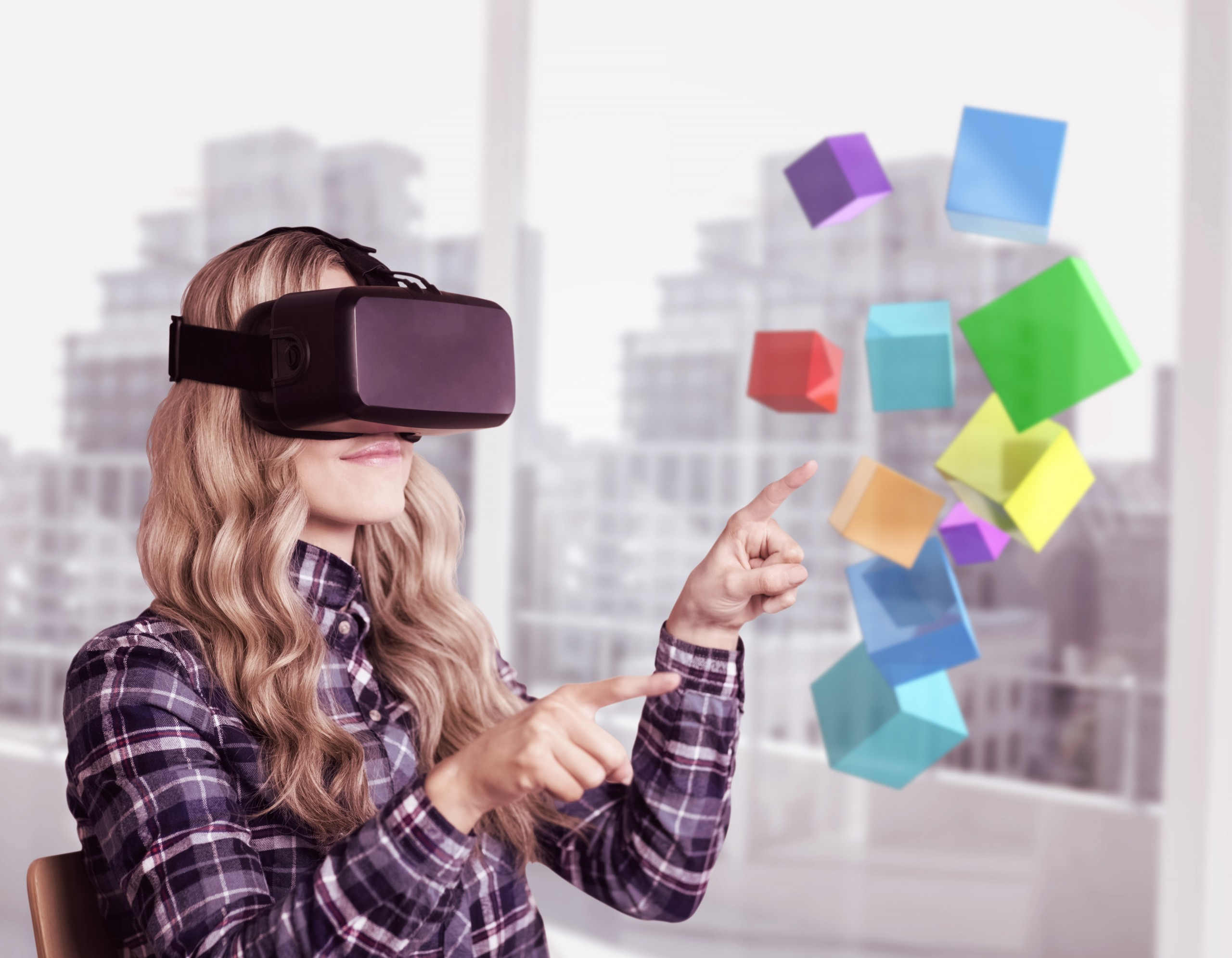 Woman manipulating virtual cubes using VR device